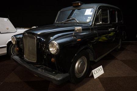 hackney carriage: MAASTRICHT, NETHERLANDS - JANUARY 08, 2015: London taxi cab LTI FX4 (Austin FX4). International Exhibition InterClassics & Topmobiel 2015