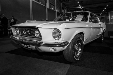 mustang gt: MAASTRICHT, NETHERLANDS - JANUARY 09, 2015: A pony car Ford Mustang GT Fastback, 1965. Black and white. International Exhibition InterClassics & Topmobiel 2015