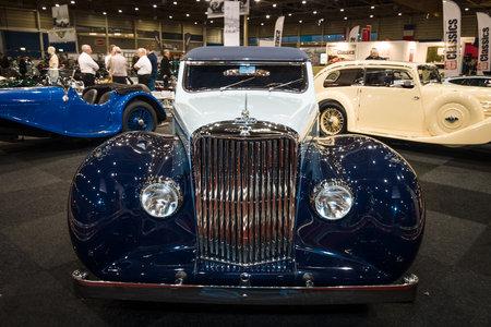 mk: MAASTRICHT, NETHERLANDS - JANUARY 09, 2015: British two-door sports saloon Jaguar Mk IV 3,5 litre Drop Head Coupe Vanden Plas, 1947. International Exhibition InterClassics & Topmobiel 2015 Editorial