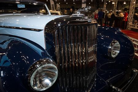 mk: MAASTRICHT, NETHERLANDS - JANUARY 09, 2015: Hood ornament of a British two-door sports saloon Jaguar Mk IV 3,5 litre Drop Head Coupe Vanden Plas, 1947. International Exhibition InterClassics & Topmobiel 2015