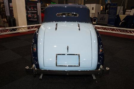 mk: MAASTRICHT, NETHERLANDS - JANUARY 09, 2015: British two-door sports saloon Jaguar Mk IV 3,5 litre Drop Head Coupe Vanden Plas, 1947. Rear view. International Exhibition InterClassics & Topmobiel 2015