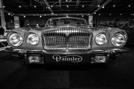 serie: MAASTRICHT, NETHERLANDS - JANUARY 09, 2015: Luxury car Daimler Sovereign Double-Six Serie 2 LWB, 1973. Black and white. International Exhibition InterClassics & Topmobiel 2015