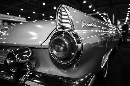 stoplights: MAASTRICHT, NETHERLANDS - JANUARY 09, 2015: A stoplight of a personal luxury car Ford Thunderbird (first generation), 1955. Black and white. International Exhibition InterClassics & Topmobiel 2015