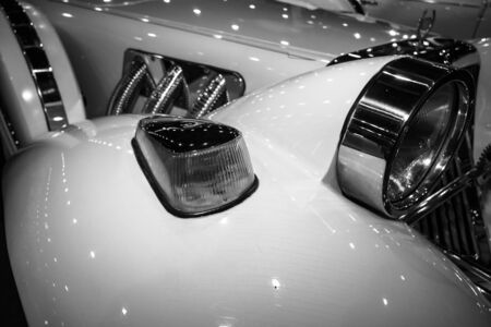 neoclassic: MAASTRICHT, NETHERLANDS - JANUARY 09, 2015: Fragment of a wedding limousine, neo-classic car Cmc Tiffany, built based on modern cars Ford. Black and white. International Exhibition InterClassics & Topmobiel 2015