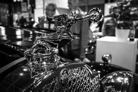 chaser: MAASTRICHT, NETHERLANDS - JANUARY 08, 2015: Hood ornament Goddess of Speed (donuts chaser) of a Packard Series 733 Coupe, 1930. Black and white. International Exhibition InterClassics & Topmobiel 2015