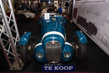 custom car: MAASTRICHT, NETHERLANDS - JANUARY 09, 2015: Custom car - race car Jaguar XK150 Vicarage Speciale, on the basis of a sports car Jaguar XK150 FHC, 1959. International Exhibition InterClassics & Topmobiel 2015 Editorial