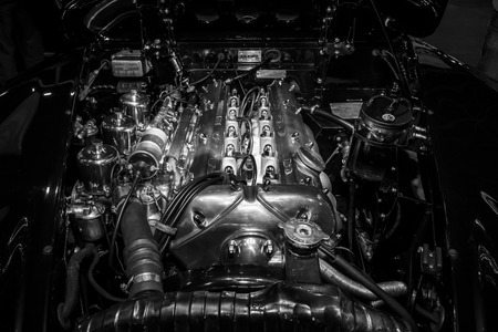 roadster: MAASTRICHT, NETHERLANDS - JANUARY 09, 2015: Engine of a Jaguar XK150 Roadster 3.4S, 1959. Black and white. International Exhibition InterClassics & Topmobiel 2015 Editorial