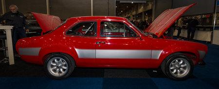 escort: MAASTRICHT, NETHERLANDS - JANUARY 09, 2015: Small family car Ford Escort RS1600. Side view. International Exhibition InterClassics & Topmobiel 2015