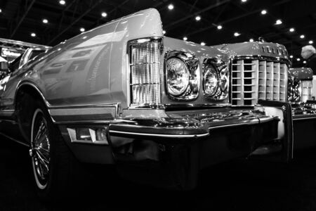 the sixth: MAASTRICHT, NETHERLANDS - JANUARY 09, 2015: A large personal luxury coupe Ford Thunderbird (sixth generation), 1976. Black and white. International Exhibition InterClassics & Topmobiel 2015