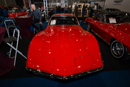 corvette: MAASTRICHT, NETHERLANDS - JANUARY 09, 2015: Sports car Chevrolet Corvette Stingray Coupe (C3). International Exhibition InterClassics & Topmobiel 2015