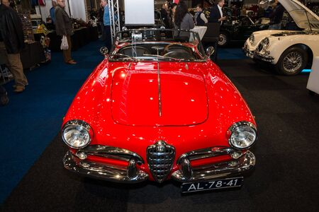 bodywork: MAASTRICHT, NETHERLANDS - JANUARY 09, 2015: Compact car Alfa Romeo Giulietta Spider, bodywork by Pininfarina. International Exhibition InterClassics & Topmobiel 2015