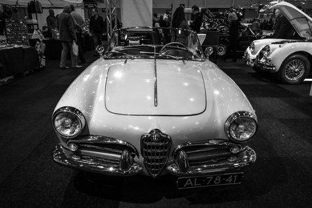 bodywork: MAASTRICHT, NETHERLANDS - JANUARY 09, 2015: Compact car Alfa Romeo Giulietta Spider, bodywork by Pininfarina. Black and white. International Exhibition InterClassics & Topmobiel 2015 Editorial