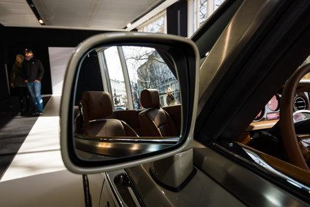 phantom: BERLIN - MARCH 08, 2015: Showroom. Rear-view mirrors of a luxury car Rolls-Royce Phantom Drophead Coupe. Rolls-Royce Motor Cars Limited global manufacturer of luxury cars.