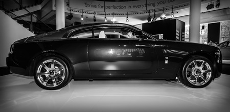 wraith: BERLIN - MARCH 08, 2015: Showroom. Full-size car Rolls-Royce Wraith (2013). Black and white. Side view. Rolls-Royce Motor Cars Limited global manufacturer of luxury cars. Editorial