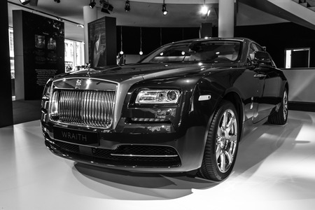 wraith: BERLIN - MARCH 08, 2015: Showroom. Full-size car Rolls-Royce Wraith (2013). Black and white. Rolls-Royce Motor Cars Limited global manufacturer of luxury cars. Editorial
