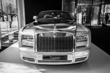 phantom: BERLIN - MARCH 08, 2015: Showroom. Luxury car Rolls-Royce Phantom Drophead Coupe. Black and white. Rolls-Royce Motor Cars Limited global manufacturer of luxury cars.