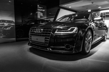 BERLIN - MARCH 08, 2015: Showroom. Full-size luxury car Audi S8. Black and white. Audi AG  is a German automobile manufacturer. Sajtókép