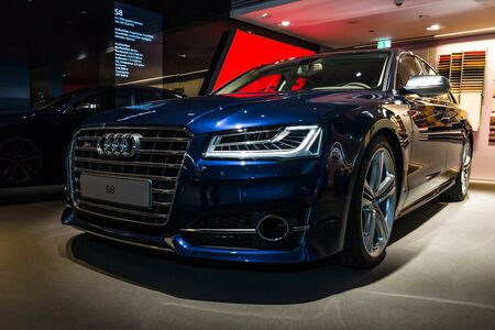 ag: BERLIN - MARCH 08, 2015: Showroom. Full-size luxury car Audi S8. Audi AG  is a German automobile manufacturer.