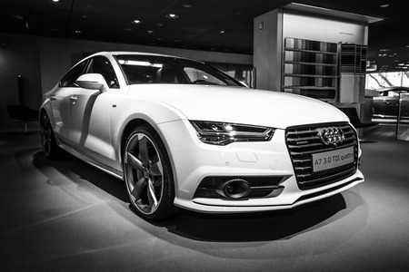 BERLIN - MARCH 08, 2015: Showroom. Executive carmid-size luxury car Audi A7 3.0 TDI quattro (2014). Black and white. Audi AG  is a German automobile manufacturer. Editorial