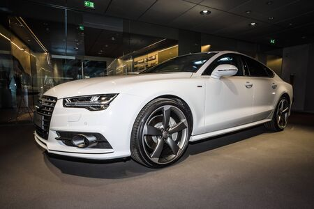 ag: BERLIN - MARCH 08, 2015: Showroom. Executive carmid-size luxury car Audi A7 3.0 TDI quattro (2014). Audi AG  is a German automobile manufacturer.