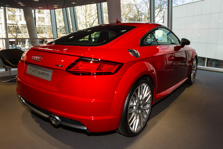 ag: BERLIN - MARCH 08, 2015: Showroom. Sports car Audi TT 2.0 T quattro (2014). Audi AG  is a German automobile manufacturer.