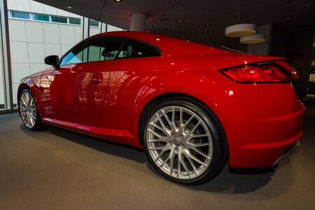 BERLIN - MARCH 08, 2015: Showroom. Sports car Audi TT 2.0 T quattro (2014). Audi AG  is a German automobile manufacturer.