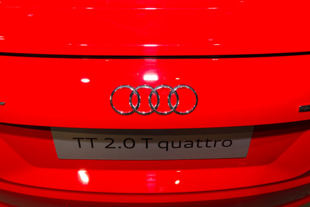 ag: BERLIN - MARCH 08, 2015: Showroom. Emblem of a sports car Audi TT 2.0 T quattro (2014). Audi AG  is a German automobile manufacturer.