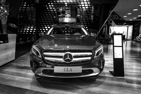 crossover: BERLIN - JANUARY 24, 2015: Compact executive crossover Mercedes-Benz GLA250 4Matic. Black and white. Produced since 2013.