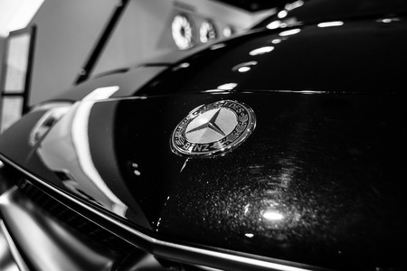 produced: BERLIN - JANUARY 24, 2015: Showroom. Hood ornament of a mid-size luxury car Mercedes-Benz CLS 63 AMG. Black and white. Produced since 2013.