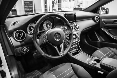 third wheel: BERLIN - JANUARY 24, 2015: Showroom. Interior of a compact car Mercedes-Benz A200 CGI BE. Black and white. Produced since 2013. Editorial