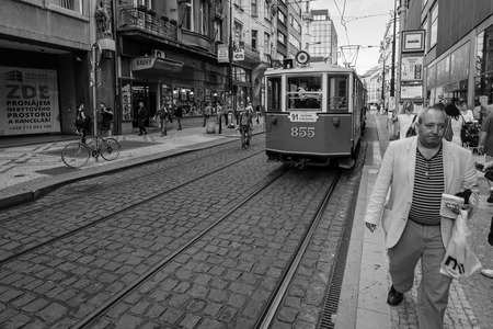 PRAGUE - SEPTEMBER 20, 2014: Street and everyday life of the city. Black and white. Prague is the capital and largest city of the Czech Republic.