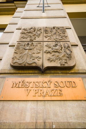 court proceedings: PRAGUE - SEPTEMBER 20, 2014: The sign Municipal Court and the coat of arms of the state. Prague is the capital and largest city of the Czech Republic.