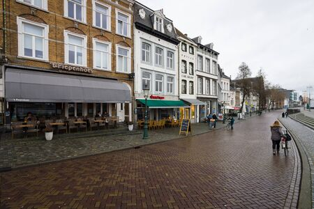 municipality: MAASTRICHT, NETHERLANDS - JANUARY 09, 2015: The narrow shopping streets in the historic center. Maastricht is the oldest city of the Netherlands and the capital city of the province of Limburg. Editorial