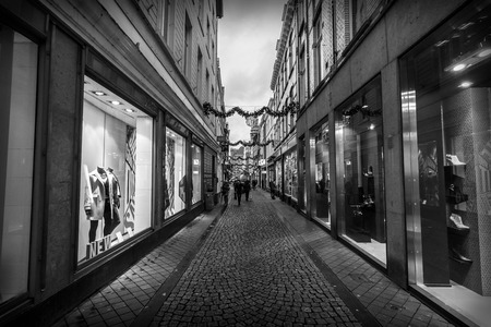 limburg: MAASTRICHT, NETHERLANDS - JANUARY 09, 2015: Old narrow street in the historic center. Black and white. Vignetting. Maastricht is the oldest city of the Netherlands and the capital city of the province of Limburg. Editorial