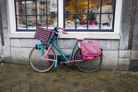 limburg: MAASTRICHT, NETHERLANDS - JANUARY 09, 2015: An unusual bike in front of a shop for the sale of sewing accessories. Maastricht is the oldest city of the Netherlands and the capital city of the province of Limburg. Editorial