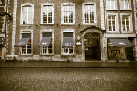 MAASTRICHT, NETHERLANDS - JANUARY 09, 2015: The streets in the historic center. Vintage toning. Stylization. Vignetting. Maastricht is the oldest city of the Netherlands and the capital city of the province of Limburg. Editorial