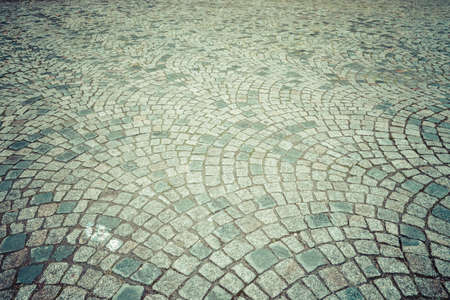 vignetting: Cobblestones. Vintage toning. Vignetting. Stylization. Background.