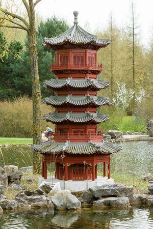 chinese garden: Miniature wooden pagoda in Chinese garden.