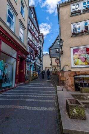 hessen: MARBURG, GERMANY - APRIL 18, 2015: Historic streets of the old quarters of Marburg. District Oberstadt. Marburg is a university town in the German federal state (Bundesland) of Hessen. Editorial