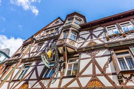 MARBURG, GERMANY - APRIL 18, 2015: The beautiful building facades of old Marburg. Marburg is a university town in the German federal state (Bundesland) of Hessen.