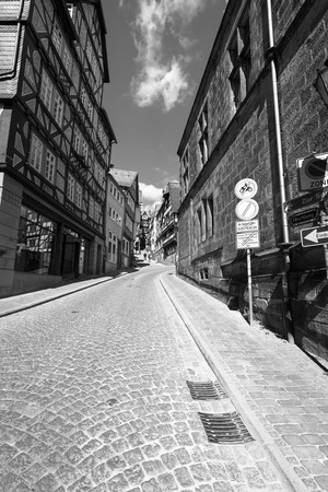 hessen: MARBURG, GERMANY - APRIL 18, 2015: Historic streets of the old quarters of Marburg. Black and white. Marburg is a university town in the German federal state (Bundesland) of Hessen.