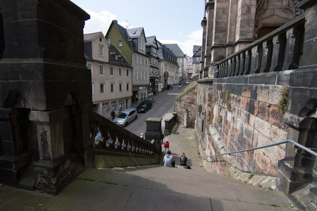 MARBURG, GERMANY - APRIL 18, 2015: Historic streets of the old quarters of Marburg. Marburg is a university town in the German federal state (Bundesland) of Hessen.