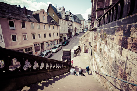 MARBURG, GERMANY - APRIL 18, 2015: Historic streets of the old quarters of Marburg. Toning. Stylization. Marburg is a university town in the German federal state (Bundesland) of Hessen.