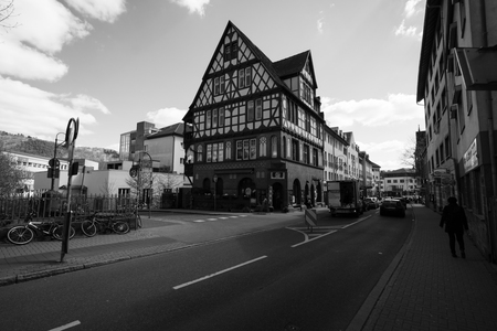 MARBURG, GERMANY - APRIL 18, 2015: Historic streets of the old quarters of Marburg. Black and white. Marburg is a university town in the German federal state (Bundesland) of Hessen.