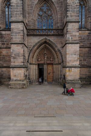 honour: MARBURG; GERMANY - APRIL 18; 2015: Main portal of St. Elizabeths Church. The medieval church was built by the Order of the Teutonic Knights in honour of St. Elizabeth of Hungary. Editorial