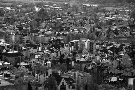hessen: MARBURG, GERMANY - APRIL 18, 2015: The new and the old part of the city from the surrounding hills. Black and white. Marburg is a university town in the German federal state (Bundesland) of Hessen.