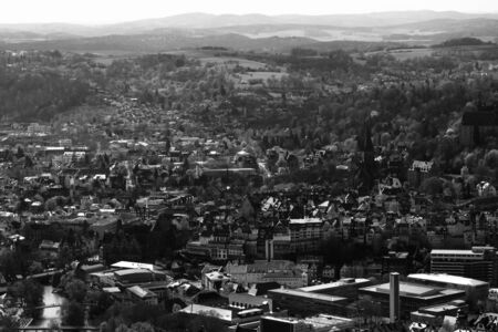 MARBURG, GERMANY - APRIL 18, 2015: The new and the old part of the city from the surrounding hills. Black and white. Marburg is a university town in the German federal state (Bundesland) of Hessen.