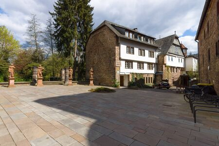 teutonic: MARBURG, GERMANY - APRIL 18, 2015: Building in the courtyard of the Church of St. Elizabeth. The medieval church was built by the Order of the Teutonic Knights in honour of St. Elizabeth of Hungary.