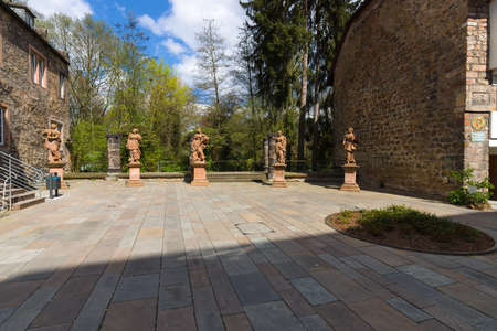 honour: MARBURG, GERMANY - APRIL 18, 2015: Building in the courtyard of the Church of St. Elizabeth. The medieval church was built by the Order of the Teutonic Knights in honour of St. Elizabeth of Hungary.