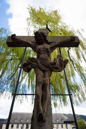 honour: MARBURG, GERMANY - APRIL 18, 2015: The Crucifixion with the Savior in the courtyard of the Church of St. Elizabeth. The medieval church was built by the Order of the Teutonic Knights in honour of St. Elizabeth of Hungary.